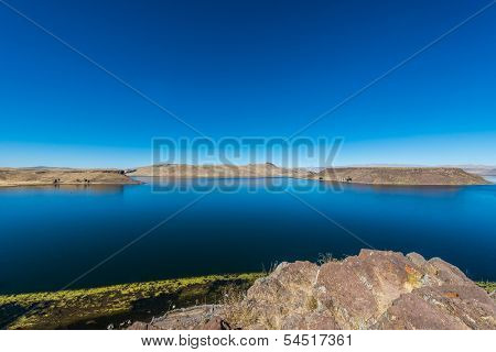 Titicaca Lake from Silustani in the peruvian Andes at Puno Peru