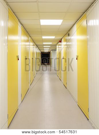 Self Storage Corridor With Yellow Doors