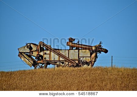 A Threshing Machine Reflects Memories of Past Harvest Days