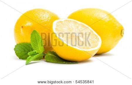 Close up of lemons with melissa, isolated on white. Concept of healthy eating and dieting lifestyle