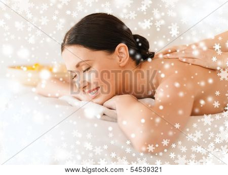 health and beauty, resort and relaxation concept - woman in spa salon getting massage