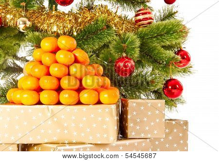 Christmas Tree With Gifts And Presents And Mandarines