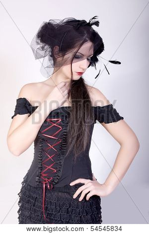 Attractive sexy widow with black veil