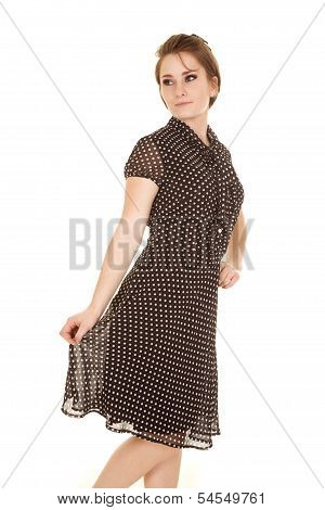 A Woman In A Dot Dress Hold Bottom Look Back