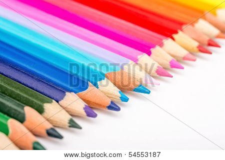Colored Pencils Row On White Background