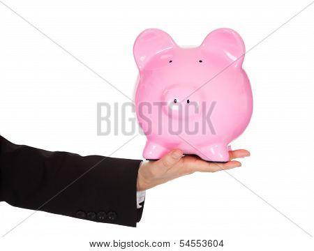 Businessman Holding Out A Piggybank