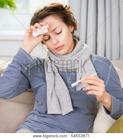 Sick Woman with Thermometer. Headache. Flu. Woman Caught Cold. Virus