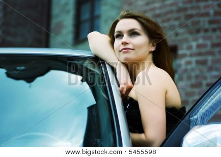 Happy Young Woman Near The Car.
