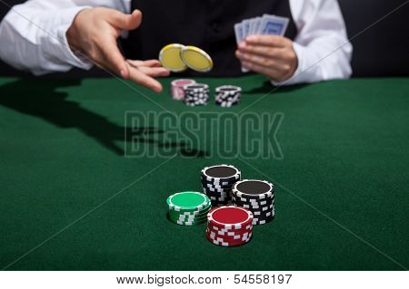 Poker Player Increasing His Stakes