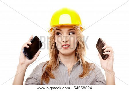 Stressed Woman Engineer Using Two Cell Phone At The Same Time
