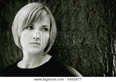 Sad Young Girl Near The Tree