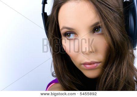 Young Woman In Earphones