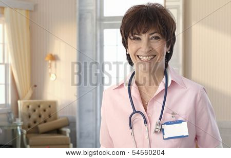 Senior nurse at elegant elite nursing-home smiling.