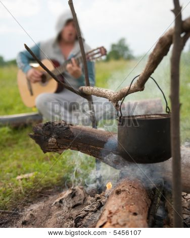 Cooking Fresh Food In Cauldron At Camp On Open Fire