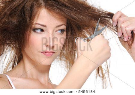 Female Cutting Her Backcombing Brunette Hair
