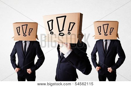 Group of men gesturing with exclamation marks drawn on box on their head