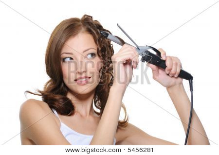Beautiful Woman Curling Her Health Hair With Roller