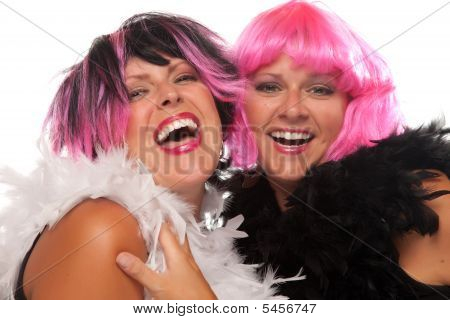 Portrait Of Two Pink And Black Haired Smiling Girls