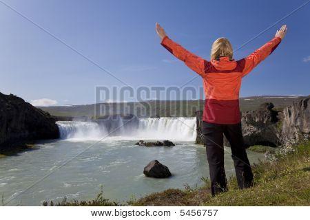 Woman Celebrating At Godafoss Waterfall, Iceland