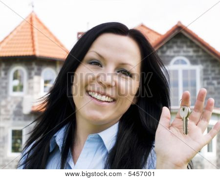 Smiling Woman Holding Keys To The House