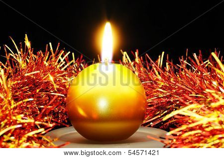 Round candle and tinsel.