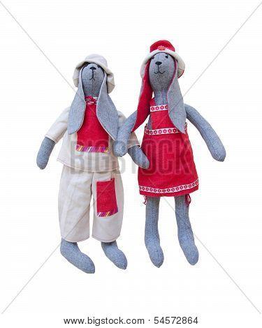 Isolated Handmade Dolls Bunny Family In Homespun Clothing