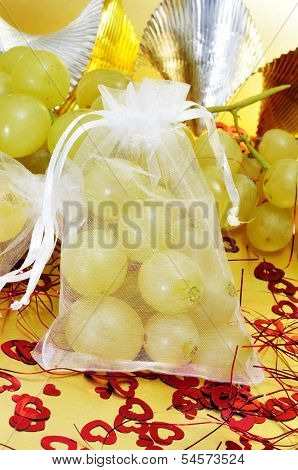 sachet with the spanish twelve grapes of luck, traditional on the New Year in Spain
