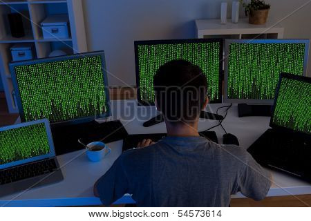 Hacker Sitting Streaming Data