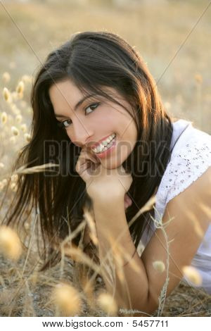 Beautiful Indian Brunette In A Golden Field