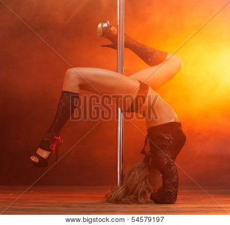 Portrait Of A Beautiful Female Dancer Performing Striptease