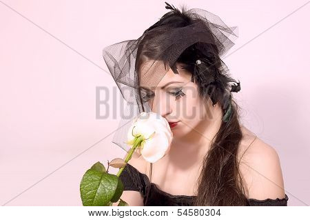Black widow woman holding flower