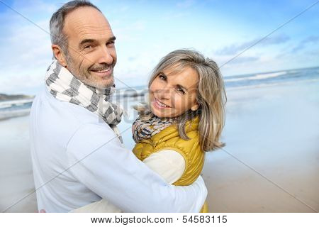 Portrait of loving senior couple at the beach