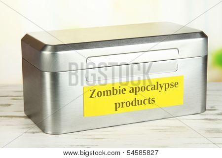 Silver box with survival items on bright background