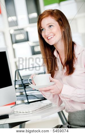 Woman At Office Desk