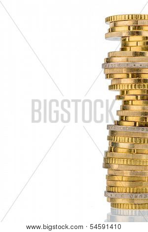 stack coins against white background. symbolic photo for taxes, fees and costs