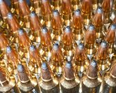 stock photo of ammo  - High powered rifle ammo group seen from the top