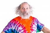 image of long beard  - Cute grey long hair and beard senior man so surprised that his eyes came out he is wearing a tie dye colorful T - JPG
