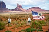 stock photo of dreamcatcher  - Large Dreamcatcher and Flag in Navajo Nation Territory - Arizona United States.