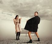 picture of exhibitionist  - funny picture of laughing woman and crazy exhibitionist in coat - JPG