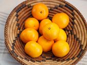 stock photo of clementine-orange  - a pile of Clementines in a basket - JPG