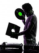 stock photo of disc jockey  - one disc jockey man holding vinyl disc in silhouette on white background - JPG