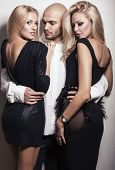image of hot couple  - man with two beautiful sexy girls with blond hair - JPG