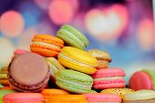 stock photo of french pastry  - french macarons on wooden table - JPG