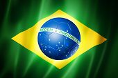 stock photo of computer-generated  - Brazil world cup 2014 symbol soccer ball on brazilian flag - JPG