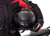 image of bicycle gear  - Smiling young man in protective gear holding a helmet under his arm with his red motorbike on a white studio background - JPG