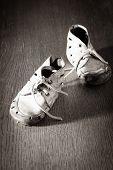 stock photo of keepsake  - Old worn baby shoes on the floor - JPG
