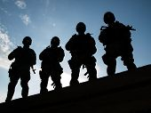 stock photo of anti-terrorism  - Silhouettes of S - JPG