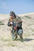 stock photo of ak 47  - soldier in bulletproof vest with ak - JPG
