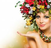 Christmas Woman. Beautiful New Year and Christmas Holiday Christmas Tree Hairstyle and Make up. Beau