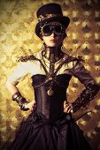 image of post-apocalypse  - Portrait of a beautiful steampunk woman over vintage background - JPG